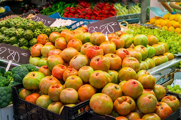 Fresh tomatoes in a market stall