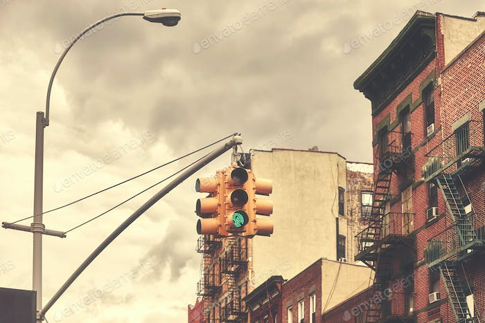 Retro toned picture of New York City traffic lights.