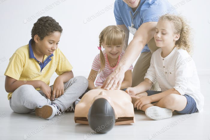 Children and paramedic have fun