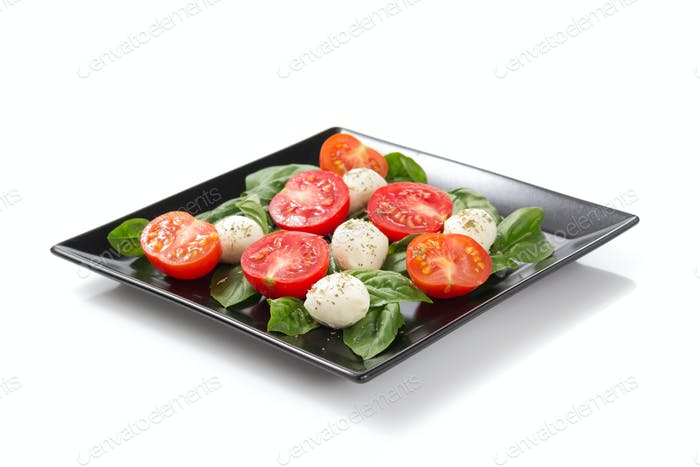 caprese salad in plate on white background