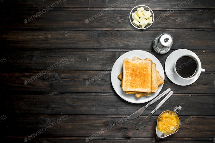 Breakfast. Toasted bread with butter and aromatic coffee.