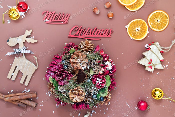 Merry Christmas background with Christmas wreaths, balls and toys , winter season. Christmas
