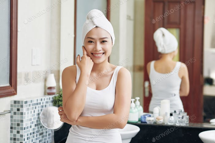 Content pure woman after shower in bathroom