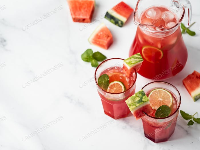 Cold watermelon, lime, mint drink. Copy space