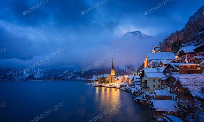 Beautiful Hallstatt lakeside town in twilight during blue hour, Winter season, Austria