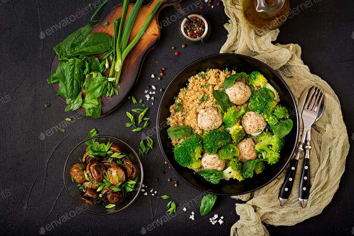 Baked meatballs of chicken fillet with garnish with quinoa and boiled broccoli.