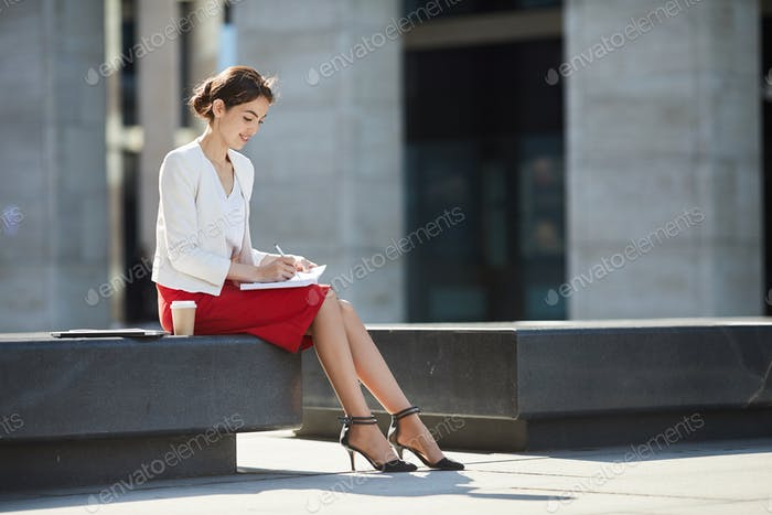 Elegant Businesswoman Relaxing Outdoors