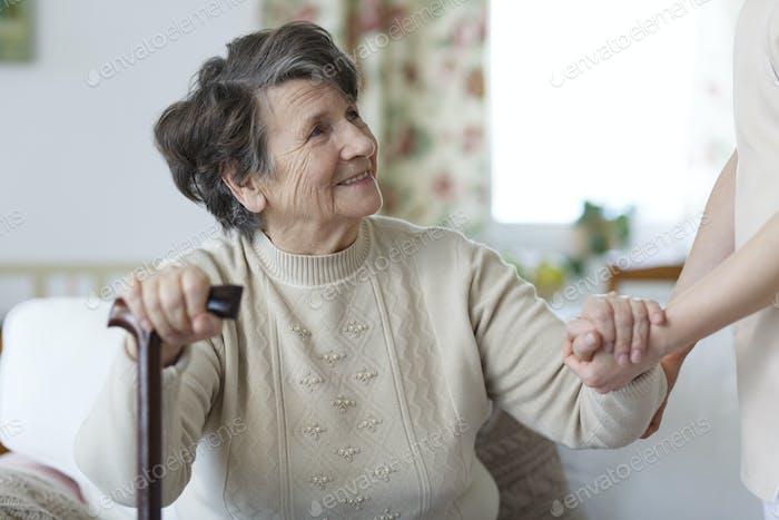 Senior woman looking at her caregiver