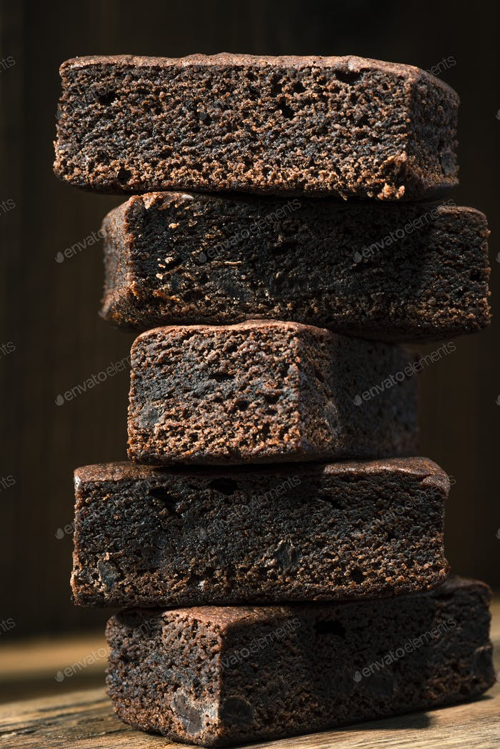 Brownie Cake Slices in Stack on Wooden Background