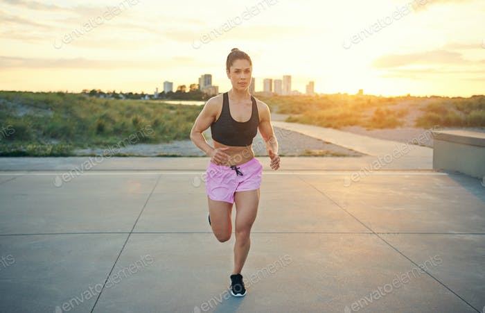 Muscular active woman working out running