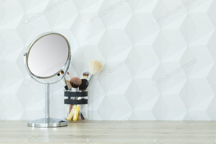 Mirror and makeup brushes