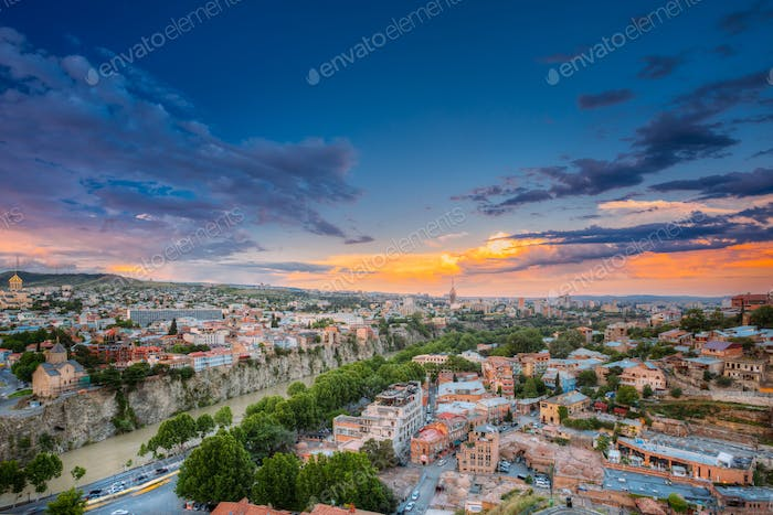 Tbilisi, Georgia. Evening Top View Of City At Colorful Sunset. C