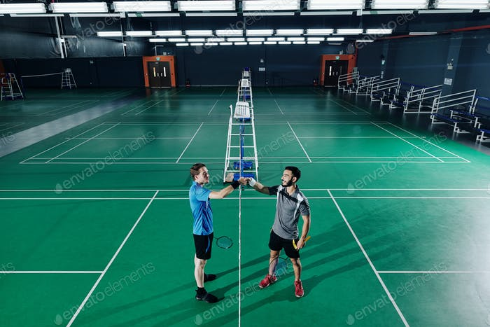 Badminton players shaking hands
