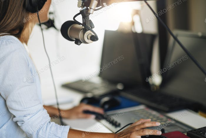 Podcast Concept - Female Host in Podcasting Studio
