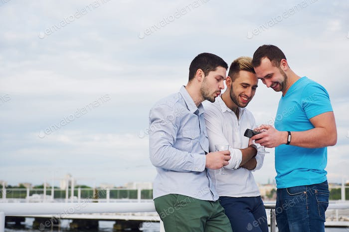 A group of young and happy men on the pier.