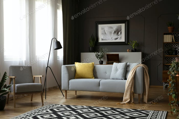 Real photo of retro armchair, modern sofa decorated with pillows