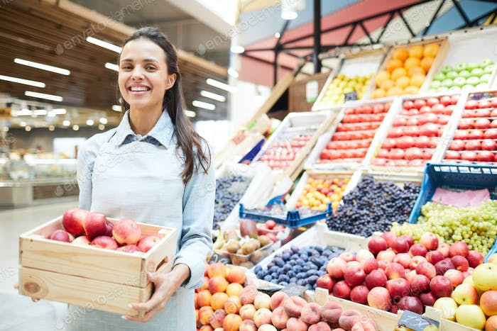 Excited grocery retailer selling fresh fruits and vegetables