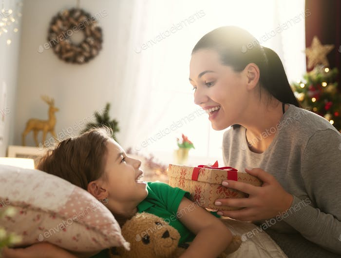 mom preparing Cristmas gift to daughter