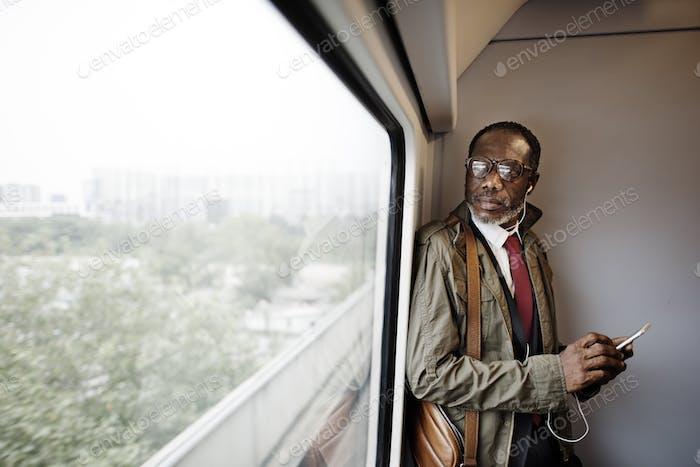 Man Traveling Train Commuter Concept