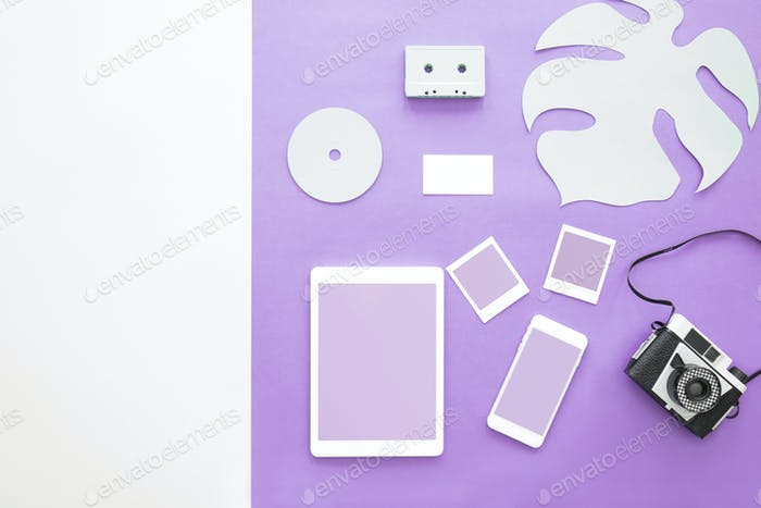 Film camera on purple background