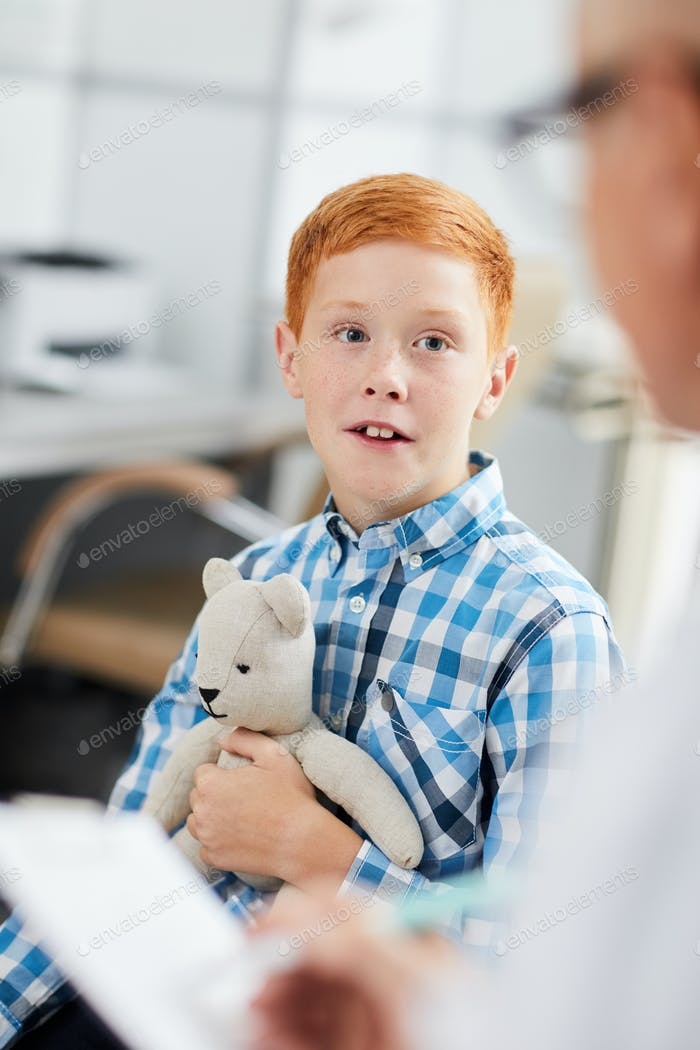 Red-Haired Boy Talking to Doctor