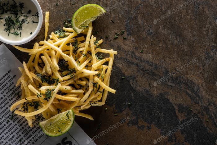 Top View of Tasty French Fries, Lime And Garlic Sauce on Marble Surface