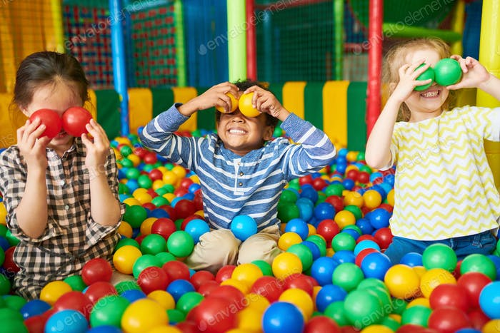 Happy Kids Playing in Ball Pit