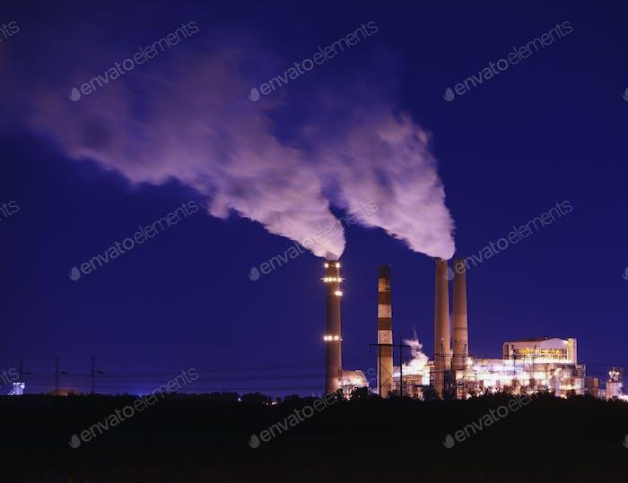 Smokestacks Billowing Smoke  At Night