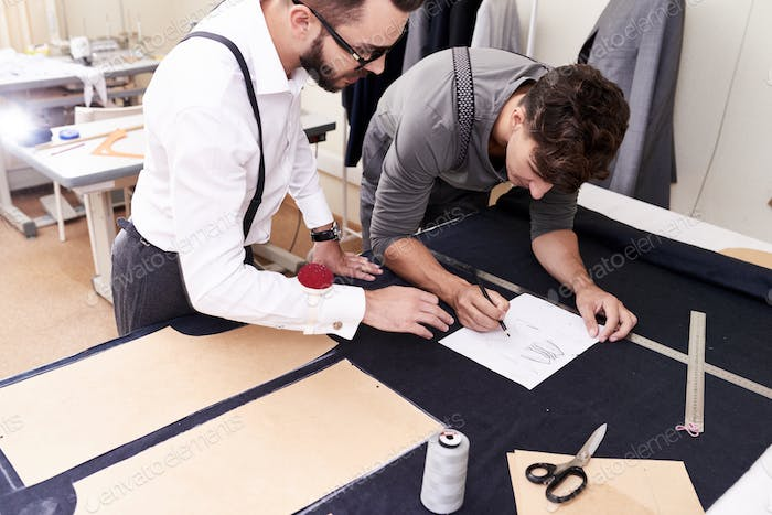 Two Tailors Working in Atelier