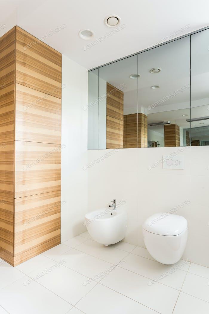 Light white bathroom with wainscot