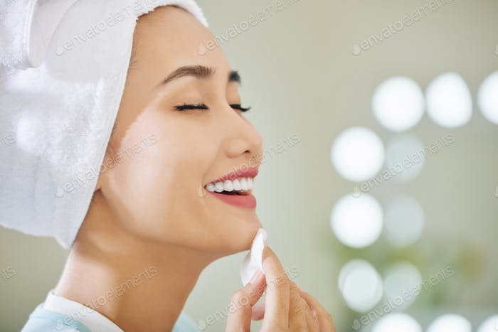 Woman applying soothing lotion