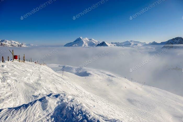 Mountains in low clouds with snow in winter