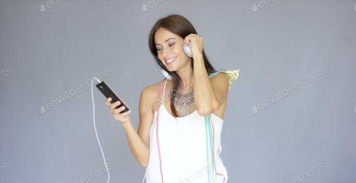 Young woman listening to music at New Year