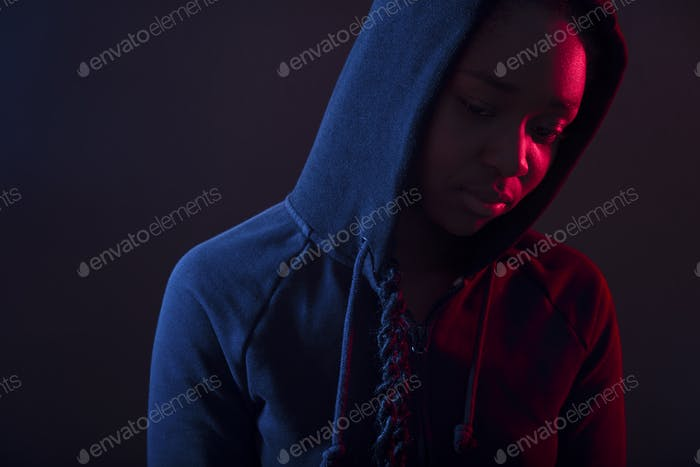 Colorful portrait of thoughtful woman with dark skin wearing hoodie