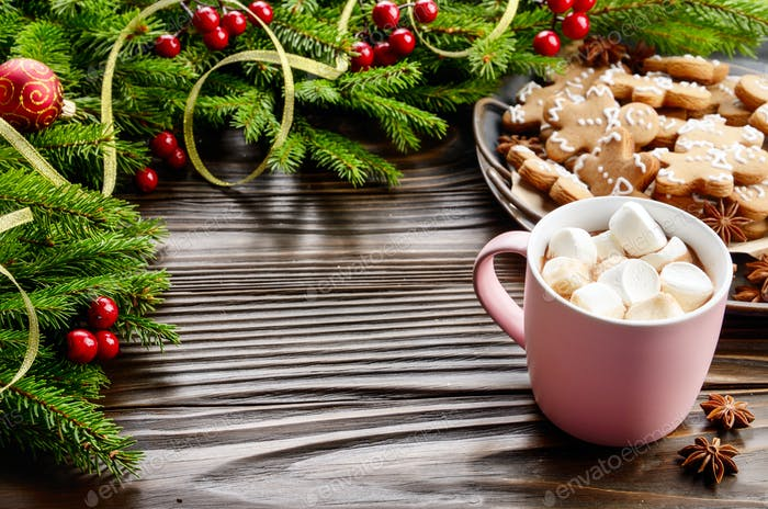 Christmas background of pink mug with hot chocolate and marshmal