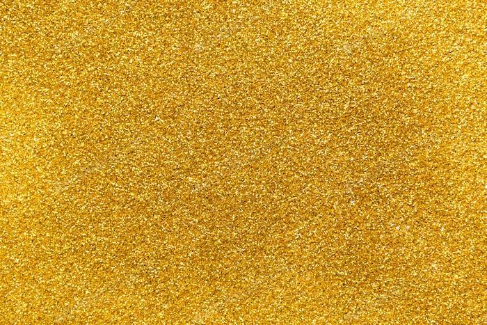 Goldener Glitter Textur abstrakter Hintergrund.