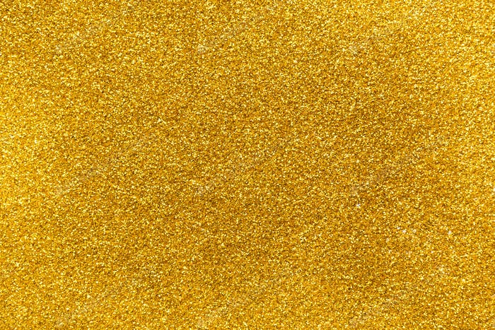 Golden glitter texture abstract background.