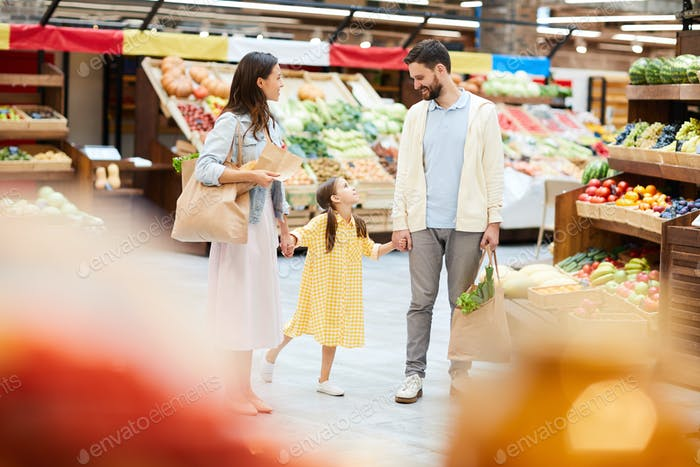 Happy young family purchasing food together