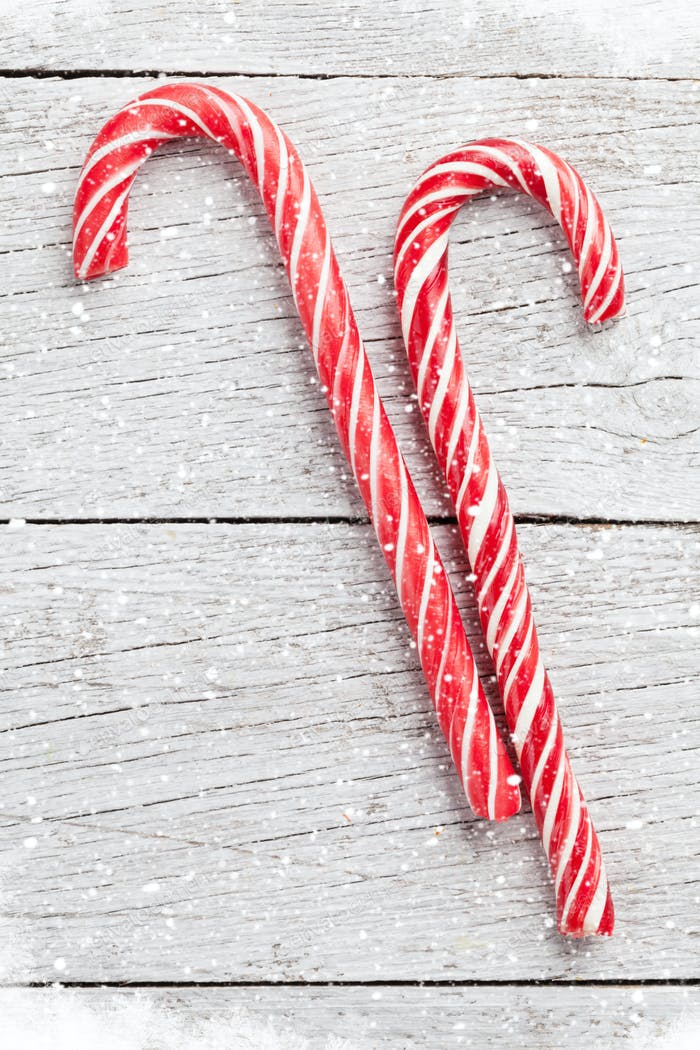 Christmas candy canes on wood