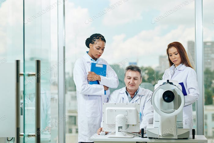 Ophthalmologist and young interns