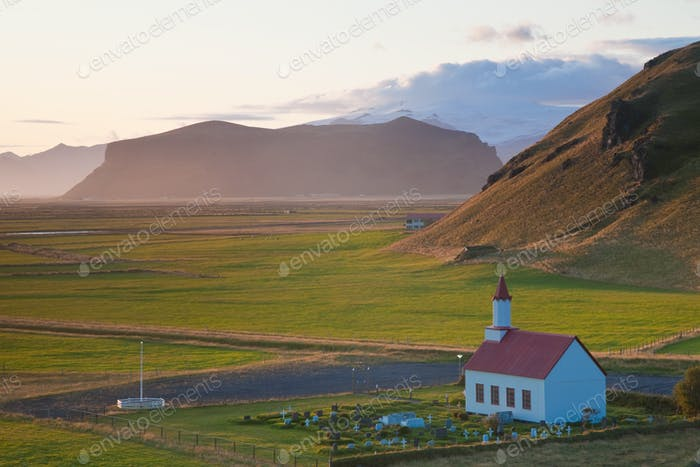Small traditional white church near Vik, in a valley.