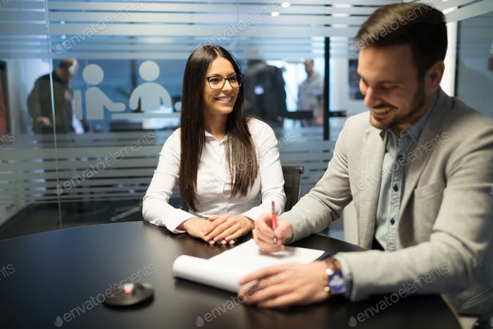 Picture of business people discussing in office