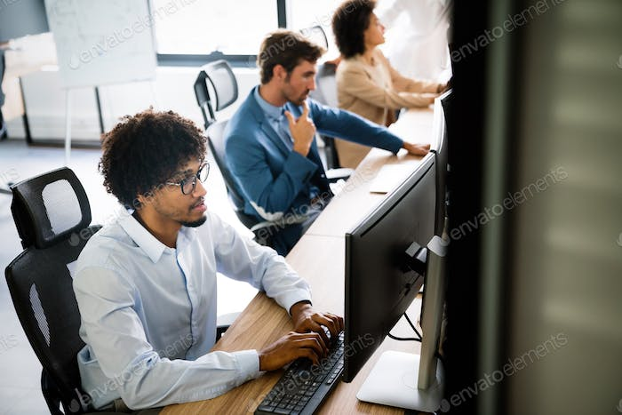 Startup programmer people group working everyday job at modern office