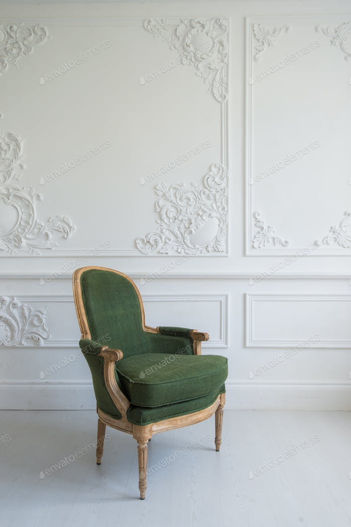elegant green armchair in luxury clean bright white interior