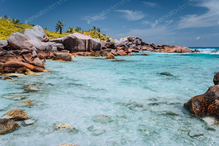 Anse Cocos beach, Seychelles. Blue turquoise lagoon and granite boulders. blue sky in background