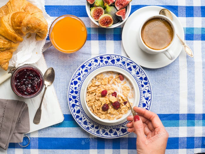Served breakfast with cereal, figs, croissant