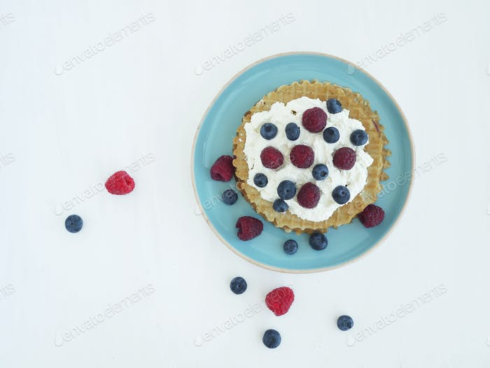 Waffels with sweet ricotta and berries