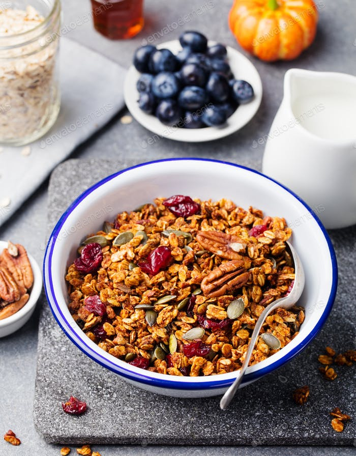 Healthy breakfast. Fresh pumpkin granola, muesli with seeds, pecan nuts, cranberries and maple syrup