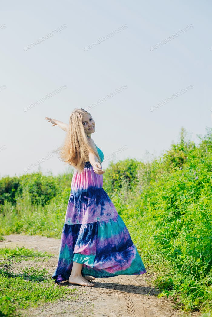 white caucasian blonde girl with colorful long dress