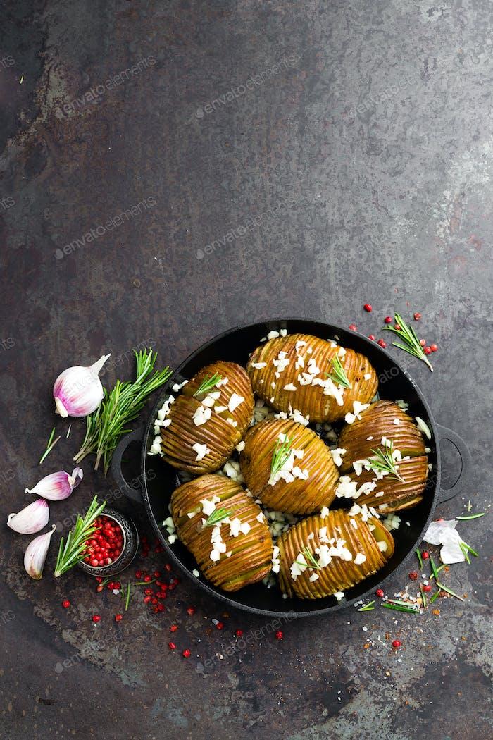 Baked potato. Potato oven baked with garlic and rosemary